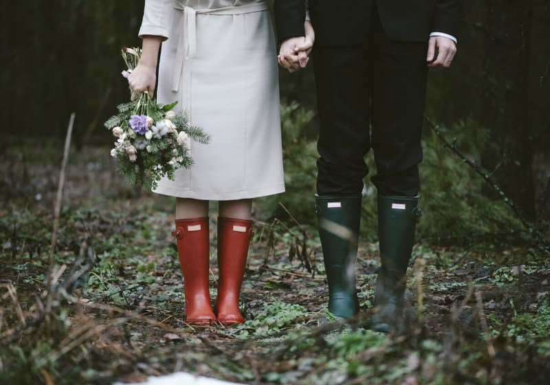 wedding couple standing forest wearing colorful | winter wear ideas for women