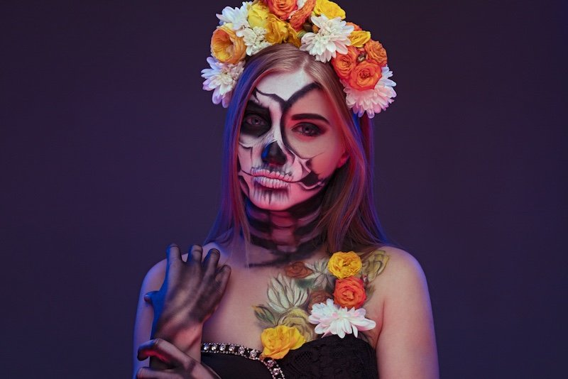 young-woman-skeleton-makeup-wearing-floral | unique halloween makeup