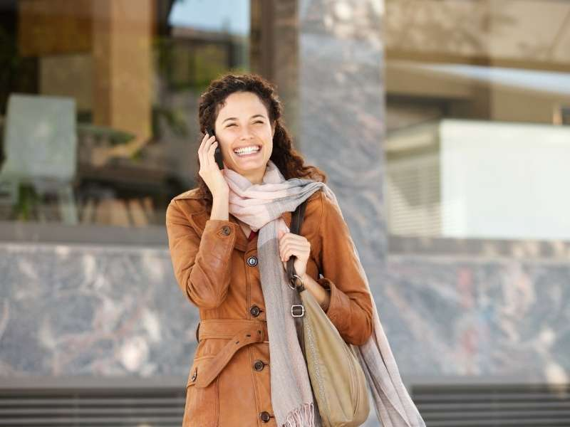 happy-woman-with-jacket-and-scarf | ways to wear scarf in cold
