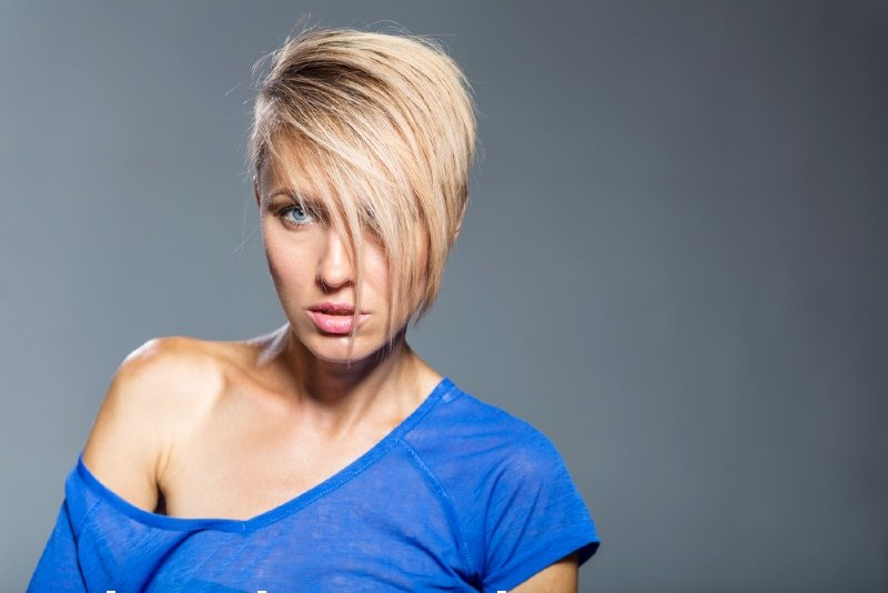 young woman short trendy haircut over | undercut fade